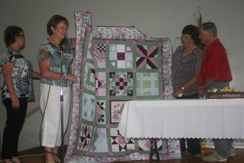 Presenting the quilt to Geoff and Edna