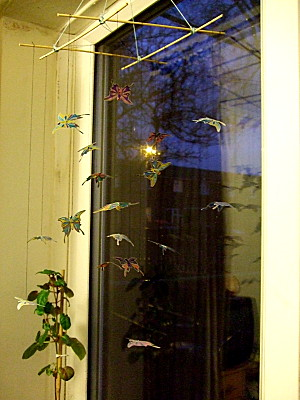 butterfly mobile, in place, in the bedroom window...