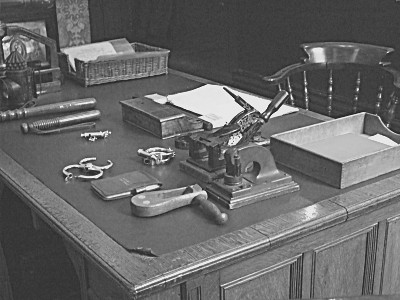 The Charge Sergeants Desk - with an array of policing tools, from a couple of truncheons for defence, to the whistle or the clacker to call for help, through to the obligatory handcuffs and a notepad...