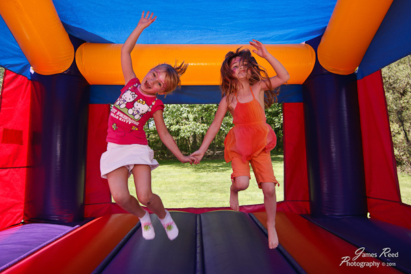 The little one and her BFF bouncing away.