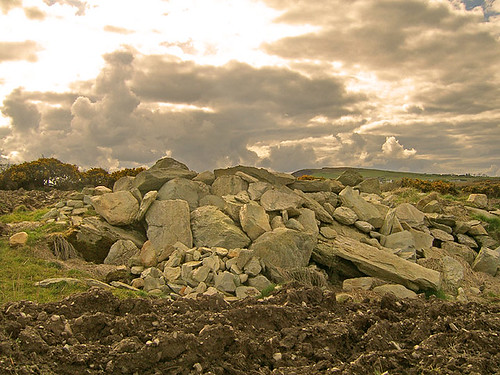 Large pile of stones inside a field