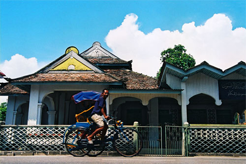 A trishaw puller in Kuala Besut. Despite his old age he is still strong cycling his trishaw ferrying the passengers around Kuala Besut town.