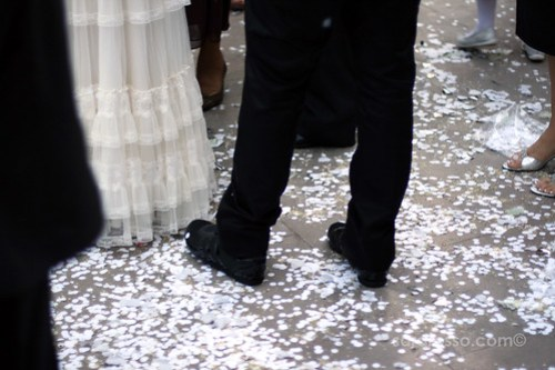 Confetti at the feet of the bride and groom in an Italian wedding