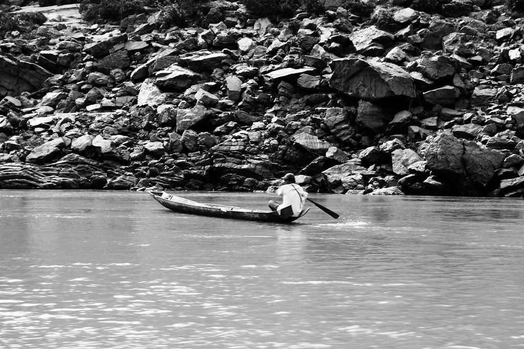 A Man Paddles Home