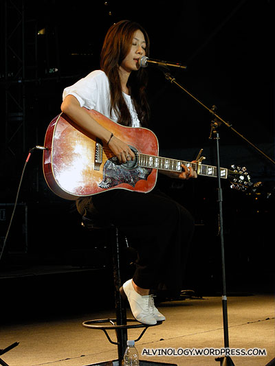 Cheer Chen on the guitar and singing