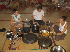 Serving a vegan breakfast of fruit salad, porridge and jaggery, which is a local and organic sugar substitute