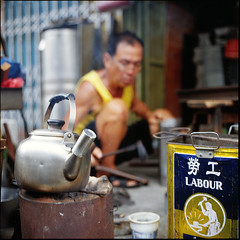 traditional tinsmith at work (lcy) Tags: travel 6x6 tlr mediumformat candid slide ishootfilm unesco worldheritagesite squareformat malaysia nostalgic dailylife e6 melaka malacca 120mm peopleatwork oldshop  tinsmith peopleportrait kodakektachromee100vs vanishingtrade rolleiflex28e dyingtrade schneiderxenotar canoscan8800f traditionaltrade