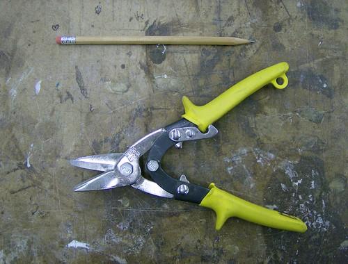 Metal snips and pencil