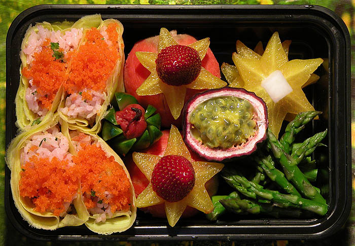 Four hamaguri-zushi, two temari zushi (under the star-fruit strawberries), cucumber sticks clasping an umeboshi, a passionfruit bowl filled with passionfruit, steamed asparagus, and a little stack of star-fruit with a radish (root) cut as square as I could manage.