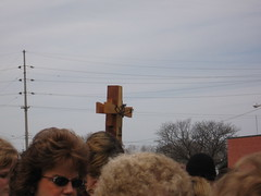 The cross goes above us