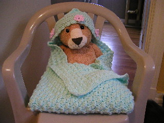 Hump-me modeling the hooded baby blanket