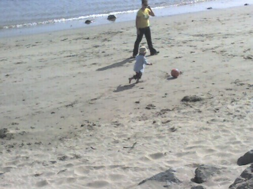 Mason playing soccer at the beach