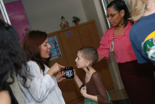 Talia tells the staff at the clinic about her trip to see Dr. G