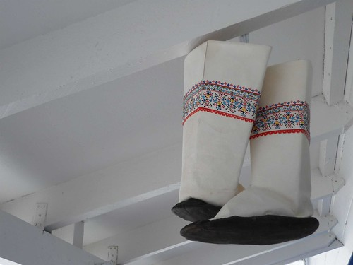 Traditional womens boots hanging outside my dads childhood home. They must be kept in a cold environment or they rot.