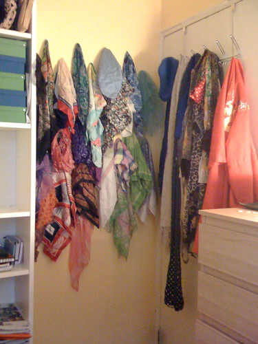 scarfs hanging on the wall and door