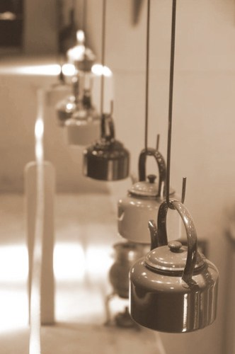Teapots hanging from the ceiling