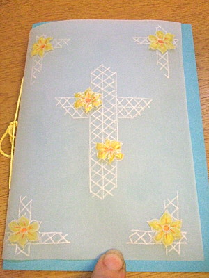 a more religious card. This went to my other grandmother. Its also made from parchment, the white lines are embossed, and the flowers are made from parchment paper also, embossed and stuck to the larger sheet.