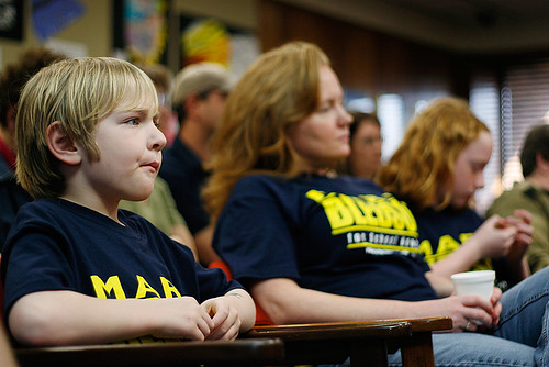 Eight-year-old Isaac Bledsoe tries to pay attention during the Columbia School Board candidate forum at the District Administration Building on March 16. Bledsoe - with his mother Ann and his 10-year-old sister Cayley - attended to support his father Marc Bledsoe, who is one of nine candidates running for a spot on the school board.