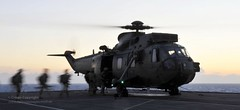 Royal Marines Board Sea King Helicopter on HMS...