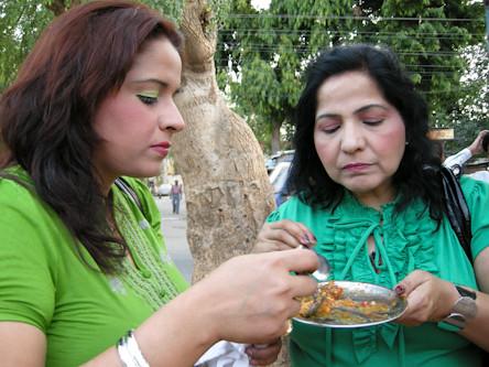 Mom and sister enjoy snacks