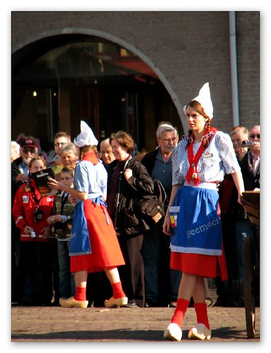 Girls in traditional costumes at Alkmaar cheese market by you.