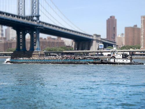Tug boat passes Manhattan Bridge 1 by you.