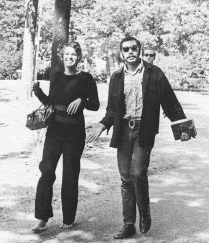 Virginia Spiess (70) walking on campus with Charles Cooper (69).