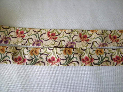 Strap fabric. Has glint of gold around flower edges, so I used a little gold on the painted flower as well.