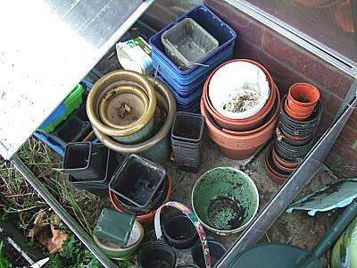 after - once id put the coldframe back, i decided to put the empty pots in there as well, until im ready for them. might as well.