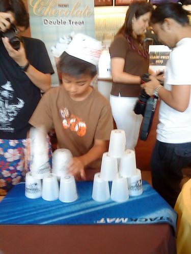 Kid playing Speed Stacking at Krispy Kreme