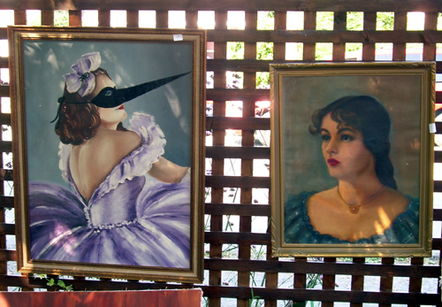Portraits on fence