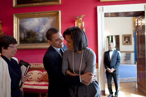 Even the people around them cant stop smiling! Official White House Photo by Pete Souza, via Flickr.