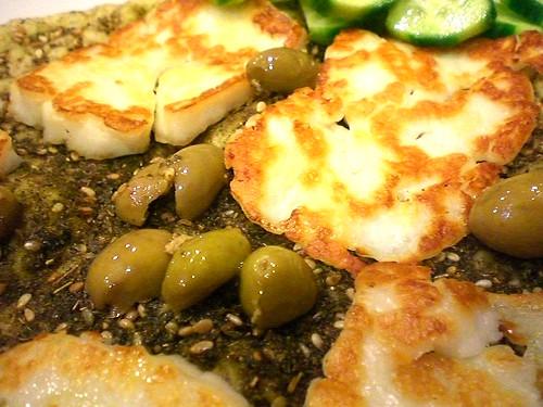 Grilled Halloumi Cheese w/ Greek olives on Zattar Bread