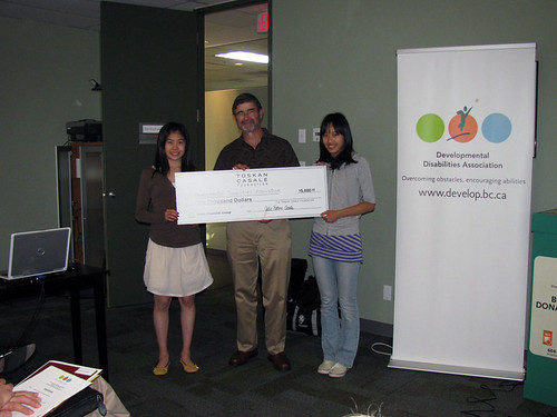 The President of our Board receiving a check from the Youth Philanthropy Initiative