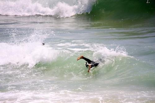 diving through a wave