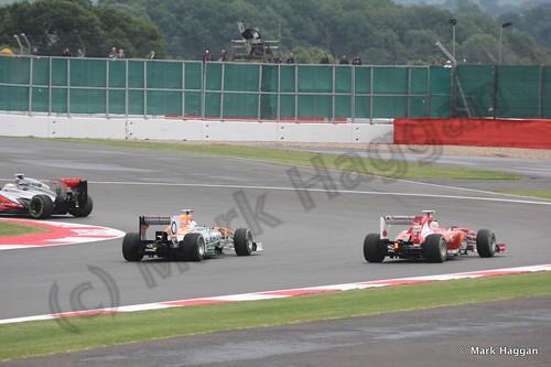 Sergio Perez, Paul Di Resta and Fernando Alonso in Free Practice 2 at the 2013 British Grand Prix