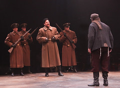 """Aaron Serotsky and Bob Amaral as Constable and Tevye, with Russian military Andrew J. Perez, Benjamin Gibson and Joseph Lewis in the Music Circus production of """"Fiddler on the Roof"""" at the Wells Fargo Pavilion Aug 14-19. Photo by Charr Crail."""