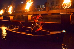 Creatures approach WaterFire by Boat