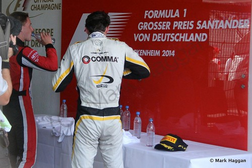Jolyon Palmer and Stoffel Vandoorne prepare for the podium after the first GP2 race at the 2014 German Grand Prix