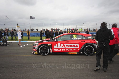 Adam Morgan heads to the grid for race two at the British Touring Car Championship 2017 at Donington Park