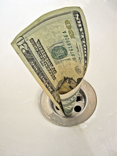Money down the drain picture