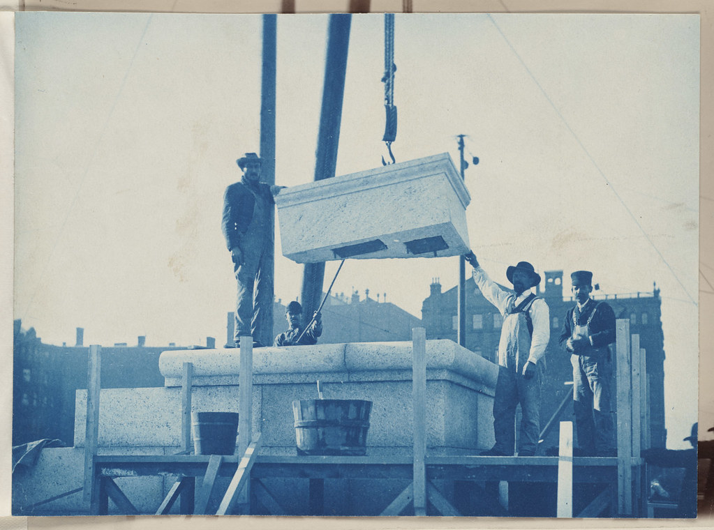 Workmen laying the cornerstone, construction of the McKim Building