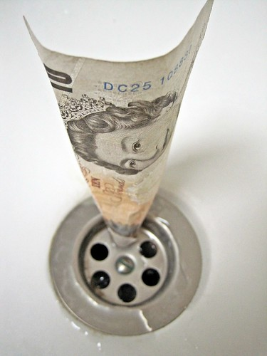 10 British Pound note down Drain
