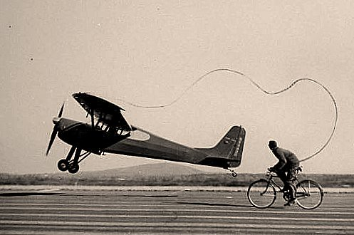 Bad idea: cyclist attached to airplane