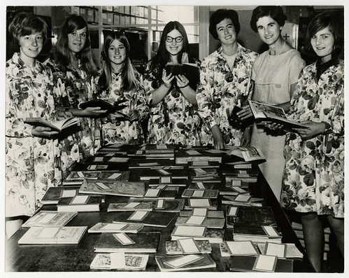 Librarians looking at display of early English Children's books