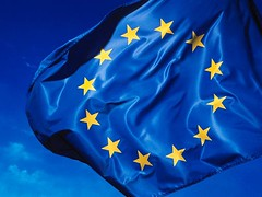 A blue flag with the European Union's 12 yellow stars
