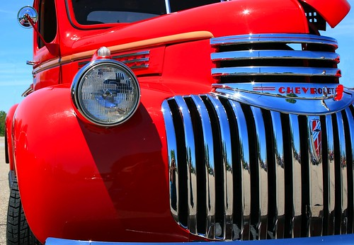 Classic red Chevrolet pickup grille. Photo copyright Jen Baker/Liberty Images; all rights reserved.
