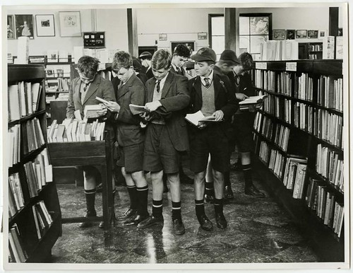 Schoolboys in the non-fiction section Canterbury Public Library
