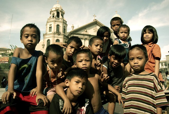 image of children in Quaipo with the famous Philippine church as background