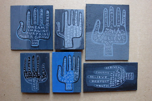 a blue group of hands by denise carbonell
